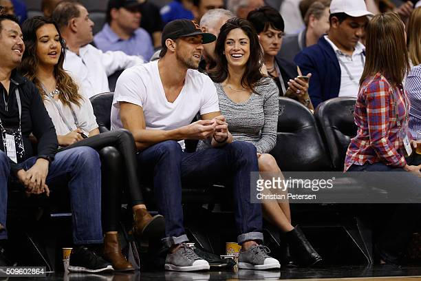 S Olympic swimmer Michael Phelps and fiancee Nicole Johnson attend the NBA game between the Phoenix Suns and the Golden State Warriors at Talking...