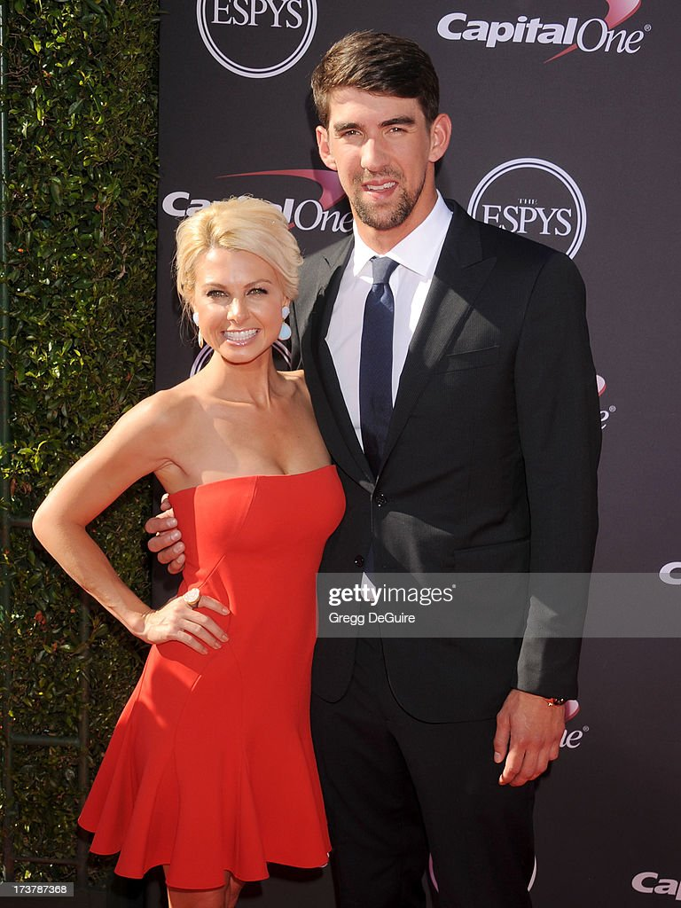 Olympic swimmer Michael Phelps and girlfriend Golf Channel reporter Win McMurry arrive at the 2013 ESPY Awards at Nokia Theatre L.A. Live on July 17, 2013 in Los Angeles, California.