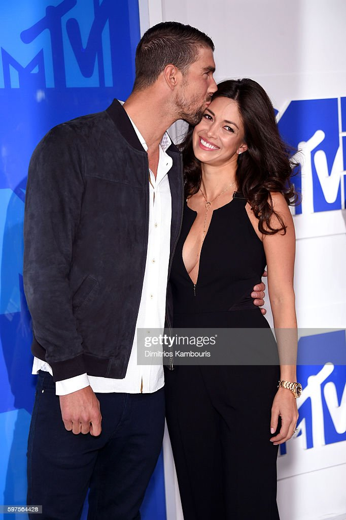 Olympic swimmer Michael Phelps (L) and Nicole Johnson attend the 2016 MTV Video Music Awards at Madison Square Garden on August 28, 2016 in New York City.