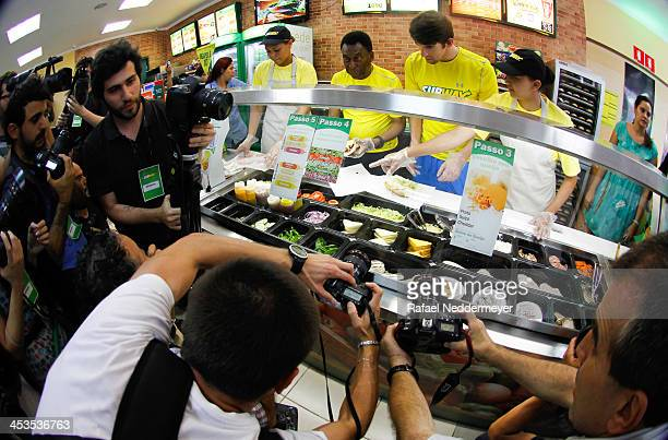 Olympic swimmer Michael Phelps and Pele make sandwiches as they attend a Subway press conference to promote healthy living and lifestyle among...