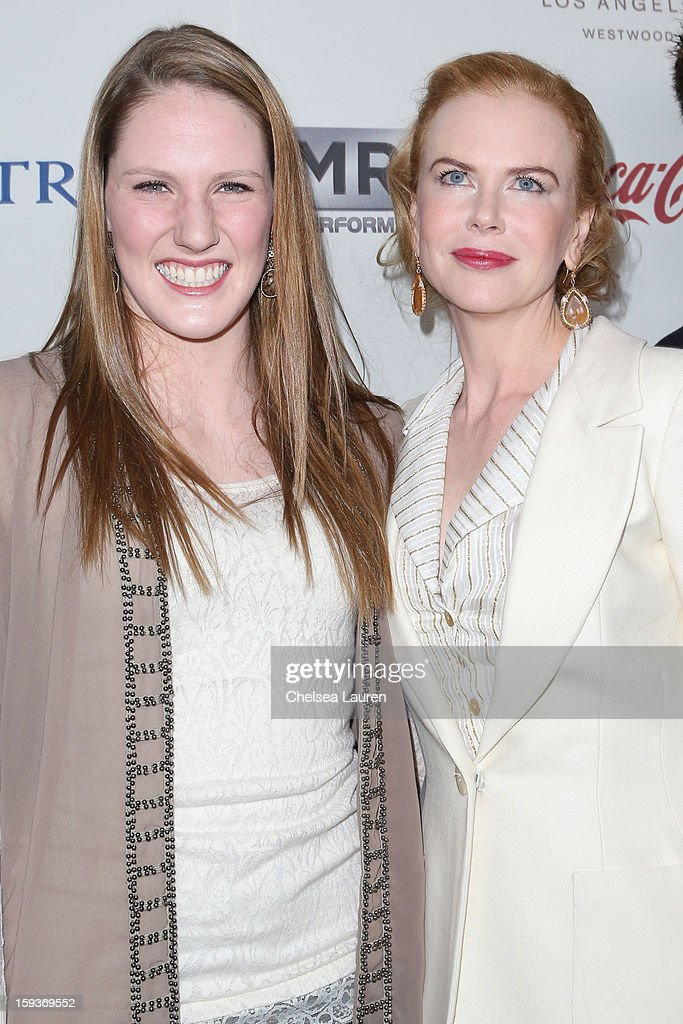 Olympic swimmer Missy Franklin (L) and actress Nicole Kidman arrive at CW3PR Presents the inaugural 'Gold Meets Golden' event at New Flagship Equinox Sports Club on January 12, 2013 in Los Angeles, California.