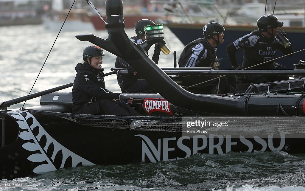 Olympic swimmer Natalie Coughlin sits on the back of the Emirates Team New Zealand skippered by Dean Barker before the start of the sixth fleet race of the America's Cup World Series on October 5, 2012 in San Francisco, California. Teams are racing on an AC45 boat, which is the forerunner to the AC72 that teams will race next year in the Louis Vuitton Cup and America's Cup Finals in San Francisco. Coughhlin was the guest racer on the Emirates boat during this race.