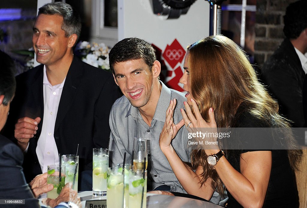 US Olympic swimmers <a gi-track='captionPersonalityLinkClicked' href=/galleries/search?phrase=Michael+Phelps&family=editorial&specificpeople=162698 ng-click='$event.stopPropagation()'>Michael Phelps</a> (C) and <a gi-track='captionPersonalityLinkClicked' href=/galleries/search?phrase=Natalie+Coughlin+-+Swimmer&family=editorial&specificpeople=171726 ng-click='$event.stopPropagation()'>Natalie Coughlin</a> attend 'Spotlight On Swimming' at OMEGA House, OMEGA's official residence during the London 2012 Olympic Games, at The House of St. Barnabas on August 7, 2012 in London, England.