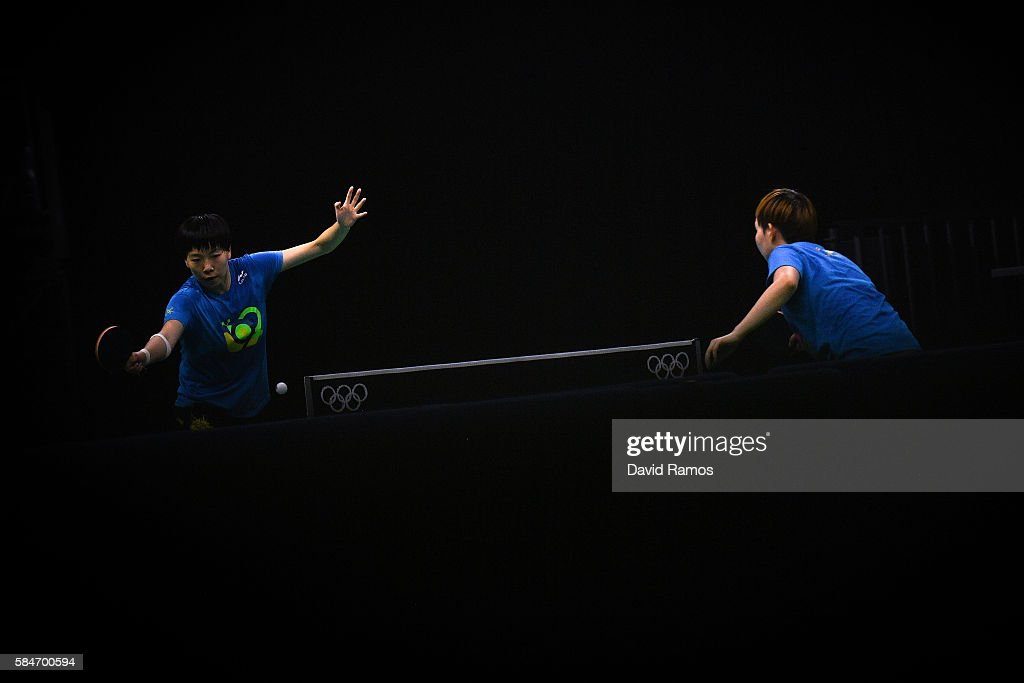 Olympic table tennis players LI Xiaoxia and Ding Ning of China practice at Riocentro Pavilion 3 on July 30 2016 in Rio de Janeiro Brazil