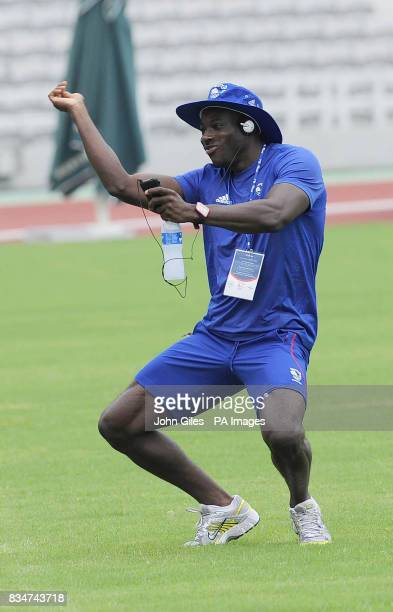 GB Olympic Team sprinter Tyrone Edgar dances to his music before he takes part in Sprint relay squad training today in Macau to complete their...
