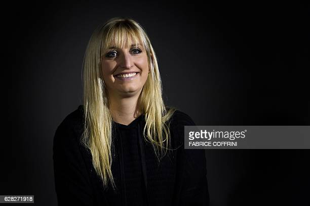 Olympic tennis double silver medalist Switzerland's Timea Bacsinszky poses for a picture during a handover ceremony on December 7 2016 at the Olympic...