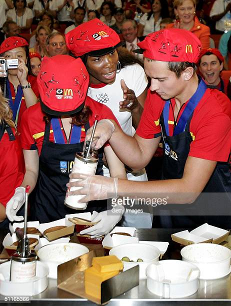 S Olympic tennis star Venus Williams shows the McDonald's Olympic Champion Crew the techniques for making the perfect Big Mac at the Main Press...