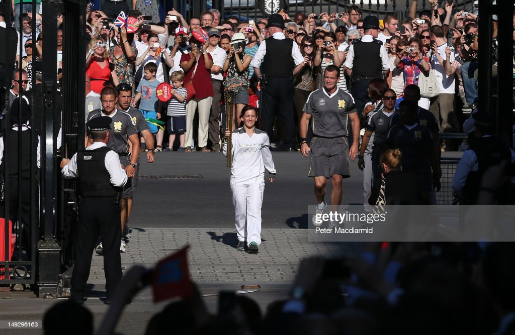 Olympic torch bearer Kate Nesbitt arrives in Downing Street on July 26, 2012 in London, England. The torch relay will end tomorrow with it's arrival at the Olympic Park for the opening ceremony of the London 2012 Games.