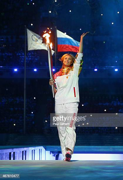 Olympic torch bearer Maria Sharapova enters the Opening Ceremony of the Sochi 2014 Winter Olympics at Fisht Olympic Stadium on February 7 2014 in...