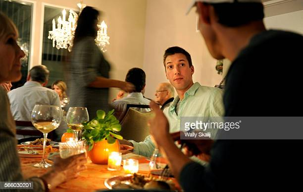 S Olympic volleyball player hopeful Jonathan Winder spends time with the family with an early Thanksgiving dinner in Irvine before leaving for France...