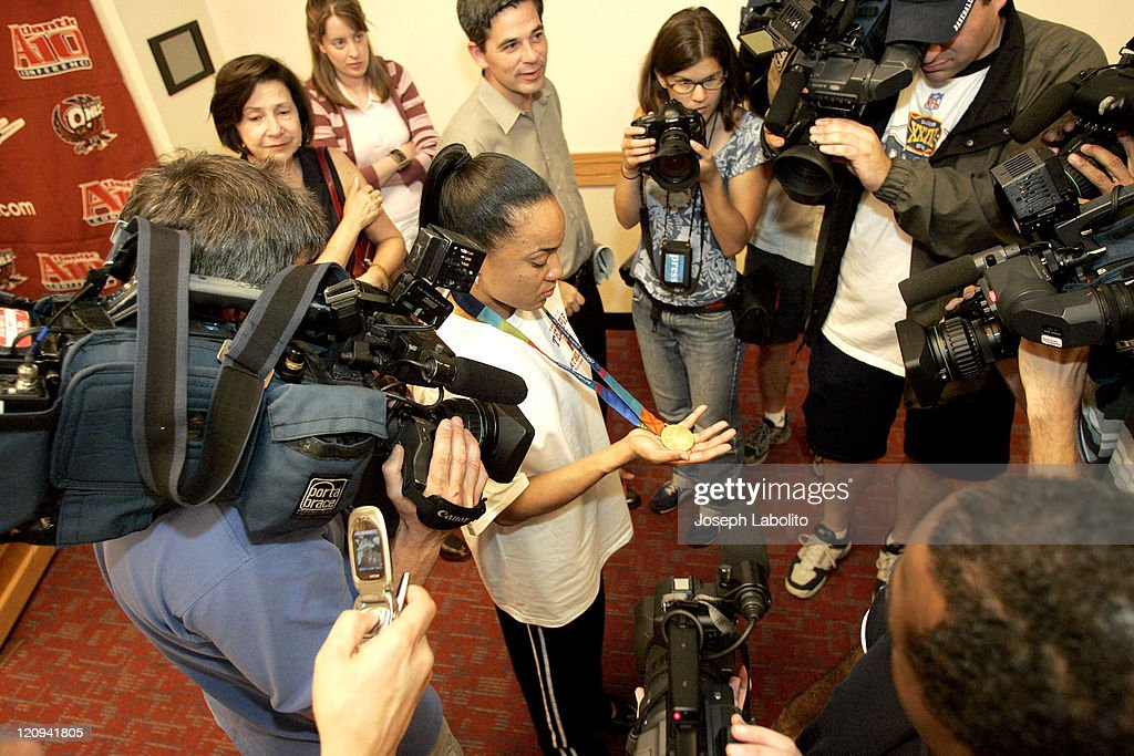 Olympic Women's Basketball Player <a gi-track='captionPersonalityLinkClicked' href=/galleries/search?phrase=Dawn+Staley&family=editorial&specificpeople=209196 ng-click='$event.stopPropagation()'>Dawn Staley</a> holds a press confrence Monday on August 30, 2004 at the Liacouras Center in Philadelphia to show her Third Olympic Gold Medal.