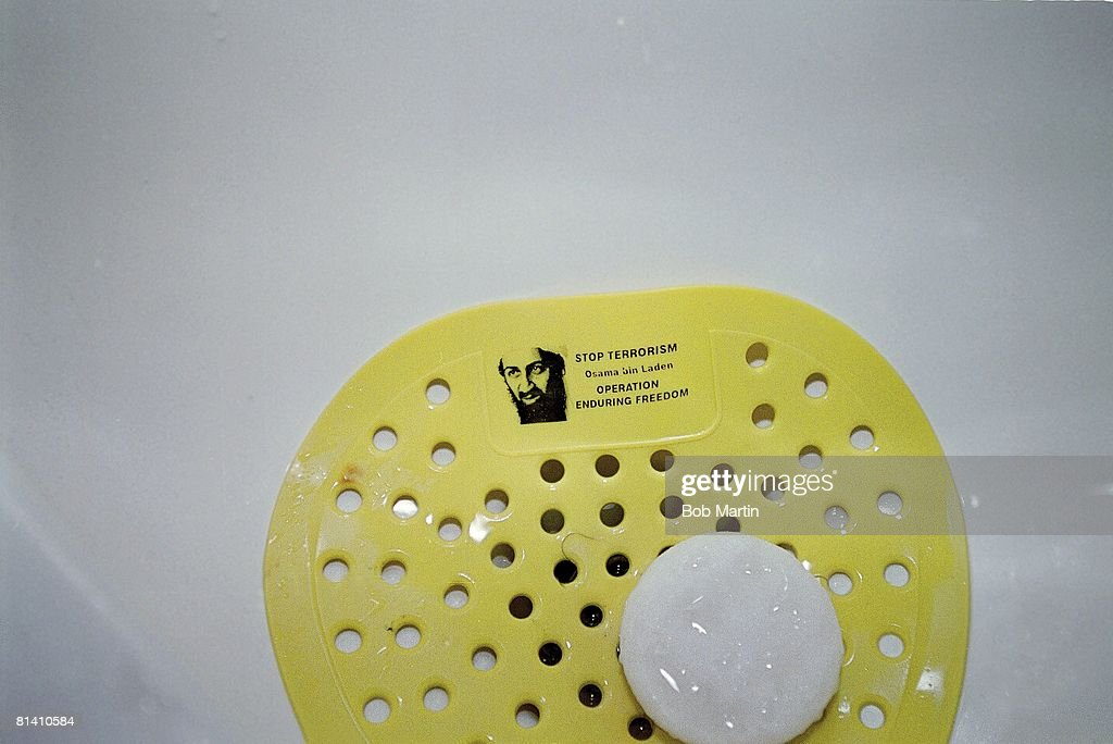 2002 Winter Olympics, Closeup of Dead Goat Saloon urinal with Osama Bin Laden picture in basin, Salt Lake City, UT 2/14/2002