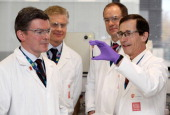 Olympics minister Hugh Robertson Paul Deighton London 2012 Chief Executive and Sir Andrew Witty CEO of GSK are shown a vial of blood by Professor...