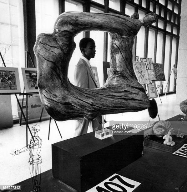 JUN 29 1981 'Olympics Of The Mind' An unidentified young man views sculpture on display at the Denver Hilton Hotel in the 'olympics of the mind'...