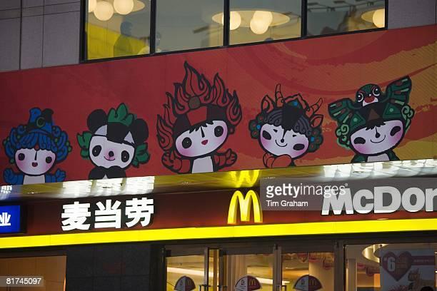Olympics official Fuwa mascot characters on McDonalds fastfood restaurant Wangfujing Street Beijing China