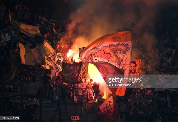 Olympique de Marseille fans cheer their team during the French Ligue 1 football match between Strasbourg and Marseille on October 15 2017 at the...