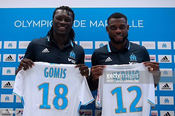 Olympique de Marseille football club recruits Bafetimbi Gomis and Henri Bedimo show theirs jerseys during a press conference on August 4 2016 at the...