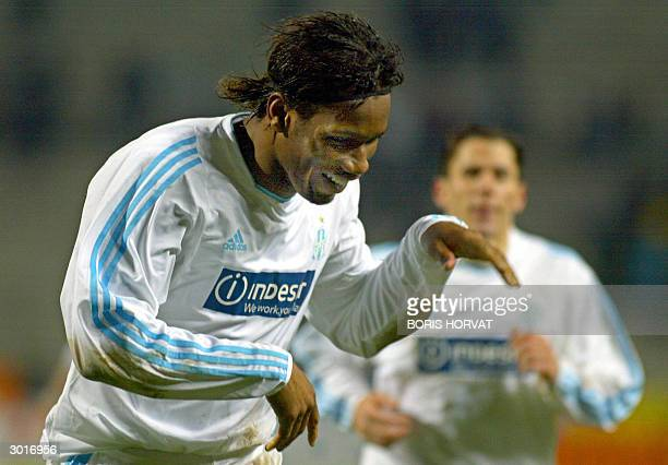 Olympique de Marseille forward Didier Drogba jubilates after scoring during the UEFA football match OM/Dniepropetrovsk 26 February 2004 at Velodrome...