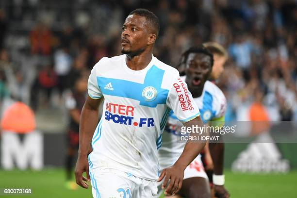 Olympique de Marseille French defender Patrice Evra celebrates after scoring the second goal during the French L1 football match between Olympique of...