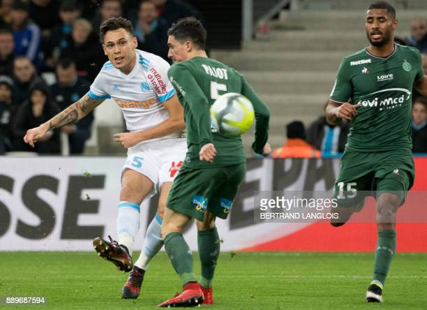 Olympique de Marseille's Argentinian forward Lucas Ocampos scores despite SaintEtienne's French midfielder Vincent Pajot during the French L1...