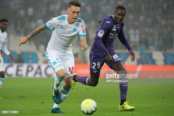 Olympique de Marseille's Argentinian forward Lucas Ocampos vies with Toulouse's midfielder Gilbert Imbula during the French L1 football match...
