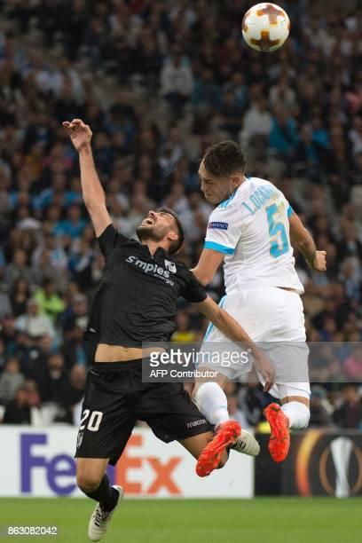 Olympique de Marseille's Argentinian forward Lucas Ocampos vies with Guimaraes' midfielder Joao Aurelio during the UEFA Europa League Group I...