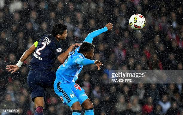 TOPSHOT Olympique de Marseille's Cameroonian forward Clinton Mia Njie vies with Paris SaintGermain's Brazilian defender Thiago Silva during the...