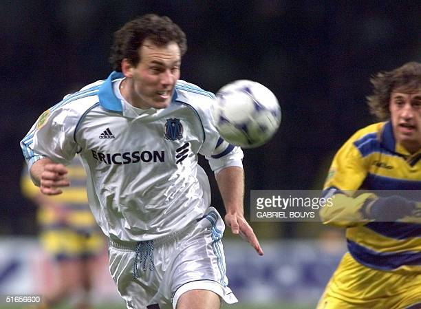 Olympique de Marseille's captain Laurent Blanc heads of the ball to give a goal to Parma 12 May 1999 at Luzhniki Stadium in Moscow during the 28th...