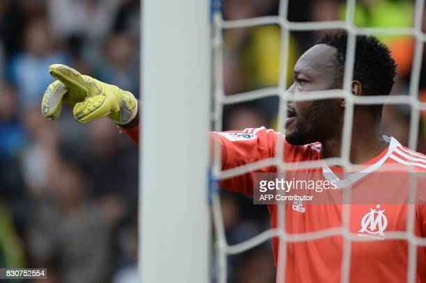 Olympique de Marseille's Congolese goalkeeper Steve Mandanda gestures during the French L1 football match between Nantes and Olympique de Marseille...