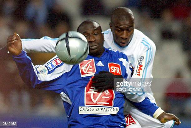 Olympique de Marseille's defender French Abdoulaye Meite fights for the ball with Racing Club Strasbourg forward Senegalese Mamadou Niang 03 January...