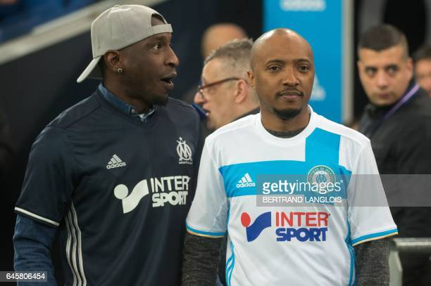 Olympique de Marseille's former player Senegalese Mamadou Niang and French singer Soprano stand prior to the French L1 football match between...