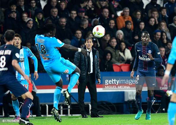 Olympique de Marseille's French coach Rudi Garcia looks at Olympique de Marseille's French forward Bafetimbi Gomis during the French L1 football...