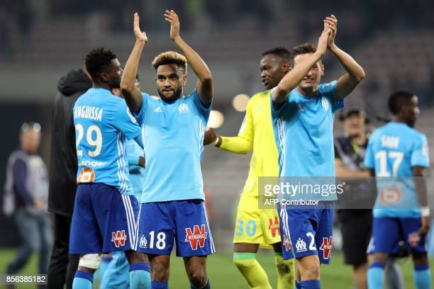 Olympique de Marseille's French defender Jordan Amavi reacts with teammates at the end of French L1 football match between Nice and Marseille on...