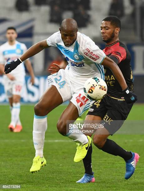 Olympique de Marseille's French defender Rod Fanni vies for the ball with Guingamp's French defender Marcus Coco during the French Ligue 1 football...