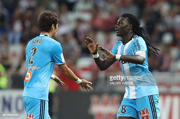 Olympique de Marseille's French forward Bafetimbi Gomis celebrates after scoring a goal during the French L1 football match OGC Nice vs Olympique de...