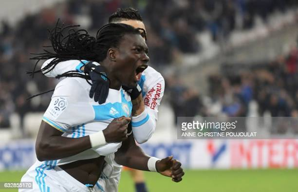 Olympique de Marseille's French forward Bafetimbi Gomis celebrates with teammates after scoring a goal during the French L1 football match between...