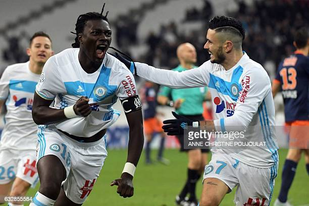 Olympique de Marseille's French forward Bafetimbi Gomis celebrates with Olympique de Marseille's French midfielder Remy Cabella after scoring a goal...