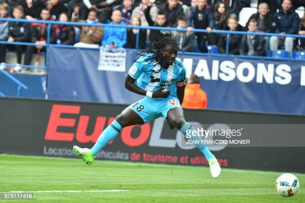 Olympique de Marseille's French forward Bafetimbi Gomis scores a goal during the French L1 football match between Caen and Marseille on April 30 at...