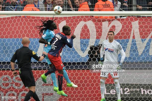 Olympique de Marseille's French forward Bafetimbi Gomis vies for the ball with Caen's French forward Yann Karamoh during the French L1 football match...