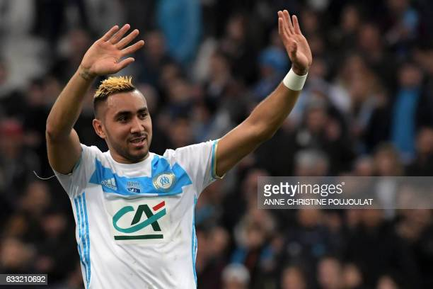 Olympique de Marseille's French forward Dimitri Payet celebrates at the end of the French Cup football match between Marseille and Lyon on January 31...