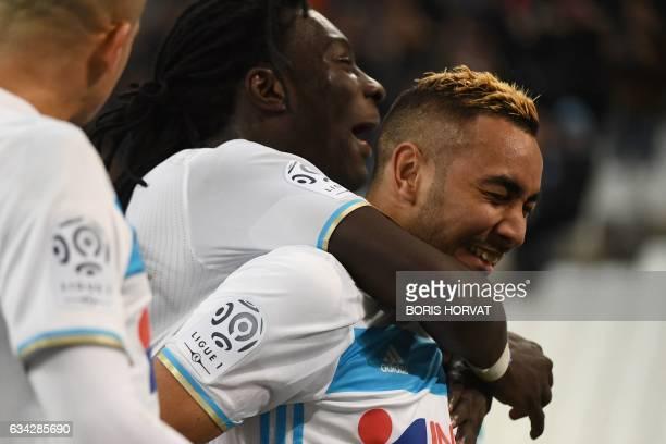 Olympique de Marseille's French forward Dimitri Payet celebrates with Olympique de Marseille's French forward Bafetimbi Gomis after scoring the...