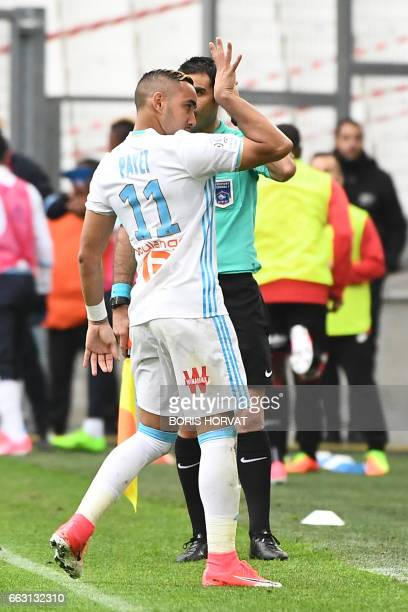 Olympique de Marseille's French forward Dimitri Payet gestures after scoring during the French L1 football match Olympique of Marseille vs Dijon at...