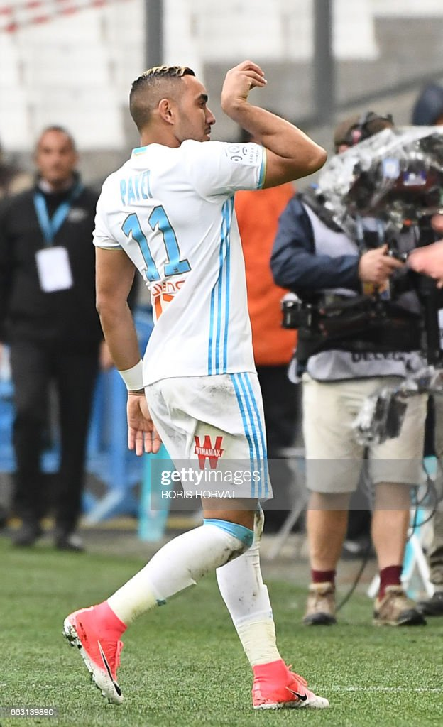 TOPSHOT - Olympique de Marseille's French forward Dimitri Payet gestures after scoring during the French L1 football match Olympique of Marseille (OM) vs Dijon at the Velodrome stadium in Marseille on April 1, 2017. /