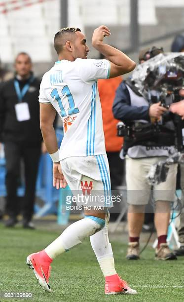 TOPSHOT Olympique de Marseille's French forward Dimitri Payet gestures after scoring during the French L1 football match Olympique of Marseille vs...