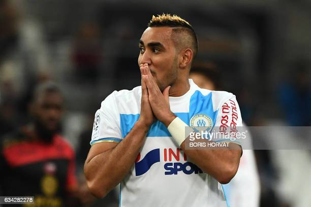 Olympique de Marseille's French forward Dimitri Payet reacts during the French Ligue 1 football match between Olympique de Marseille and Guingamp at...
