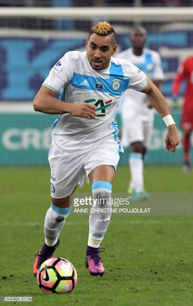 Olympique de Marseille's French forward Dimitri Payet runs for the ballduring the French Cup football match between Marseille and Lyon on January 31...