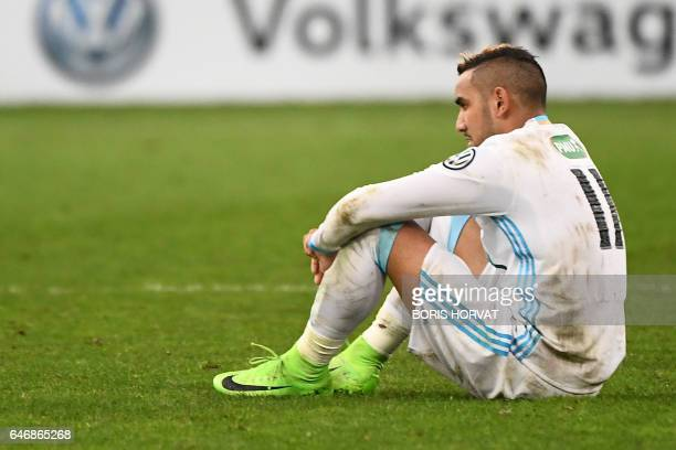 Olympique de Marseille's French forward Dimitri Payet sits on the pitch after Marseille lost the French Cup football match Marseille vs Monaco on...