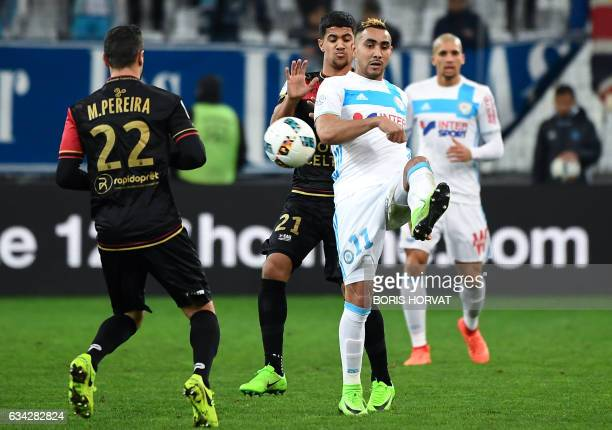 Olympique de Marseille's French forward Dimitri Payet vies for the ball with Guingamp's French midfielder Ludovic Blas during the French Ligue 1...