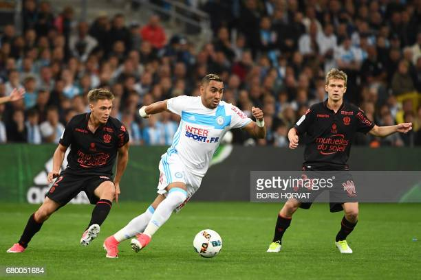 Olympique de Marseille's French forward Dimitri Payet vies with Nice's French defender Arnaud Souquet and Nice's French midfielder Vincent Koziello...