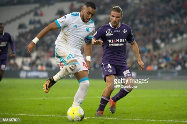 Olympique de Marseille's French forward Dimitri Payet vies with Toulouse's French midfielder Yannick Cahuzac during the French L1 football match...